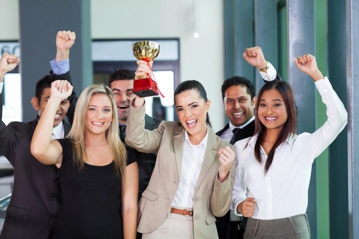 Millennials holding a trophy