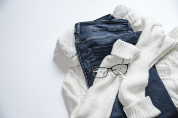 Canva - Black Framed Eyeglasses On White Jacket And Blue Denim Bottoms